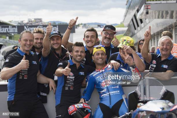 Mattia Pasini of Italy and Italtrans Racing Team celebrates with team the Moto2 pole position during the MotoGp of Austria Qualifying at Red Bull...