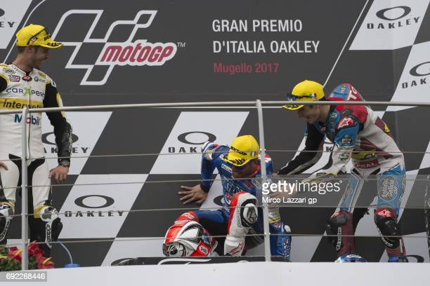 Mattia Pasini of Italy and Italtrans Racing Team crash on the podium and celebrates the victory at the end of the Moto2 race during the MotoGp of...