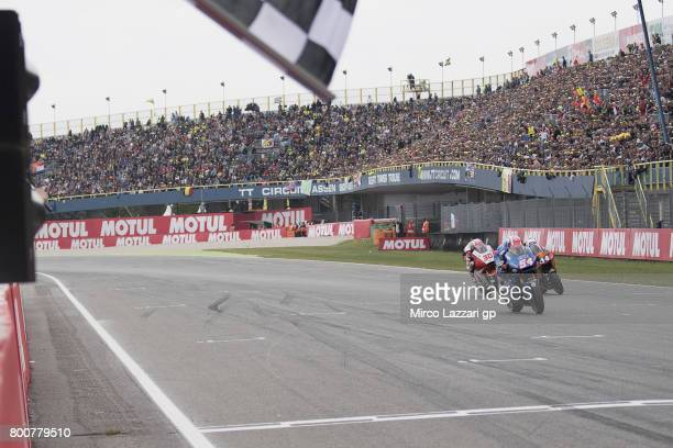 Mattia Pasini of Italy and Italtrans Racing Team cuts the finish line during the Moto2 Race during the MotoGP Netherlands Race on June 25 2017 in...