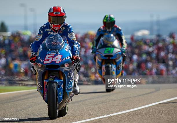Mattia Pasini of Italy and Italtrans Racing Team Kalex and Franco Morbidelli of Italy and Eg 00 Marc Vds Kalex after the Moto2 race for the MotoGP of...