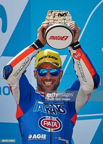 Mattia Pasini of Italy and Italtrans Racing Team Kalex celebrates at the podium after the Moto2 race for the MotoGP of Aragon at Motorland Aragon...