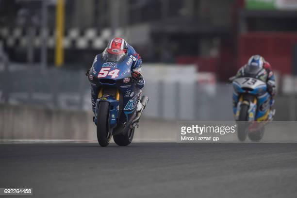 Mattia Pasini of Italy and Italtrans Racing Team leads Alex Marquez of Spain and EG 00 Marc VDS during the Moto2 race during the MotoGp of Italy Race...