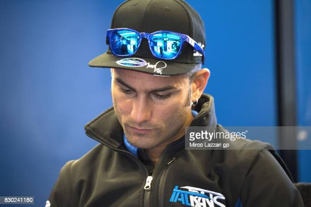 Mattia Pasini of Italy and Italtrans Racing Team looks on in box during the MotoGp of Austria Free Practice at Red Bull Ring on August 11 2017 in...