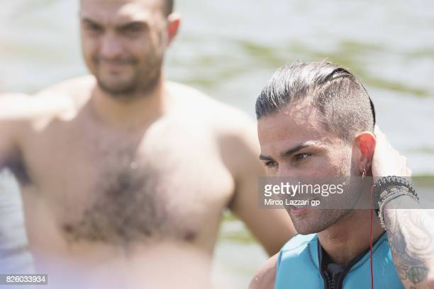 Mattia Pasini of Italy and Italtrans Racing Team smiles during the preevent 'Motogp riders make a JetSurf competition at the Brno Dam' during the...