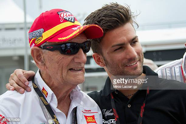Mattia Pasini of Italy and Speed Master poses with Phil Read of Great Britain on grid during the preevent 'MotoGP riders celebrate Sachsenring's 85th...