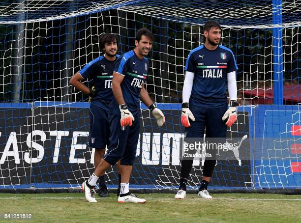 Mattia Perin Gianluigi Buffon and Gianluigi Donnarumma of Italy look on during the training session at Italy club's training ground at Coverciano on...