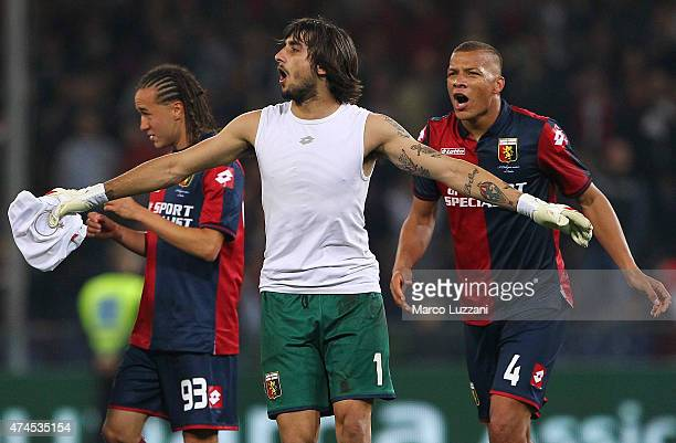 Mattia Perin Suarez Diego Sebastian Laxalt and Sebastian De Maio of Genoa CFC celebrate a victory at the end of the Serie A match between Genoa CFC...