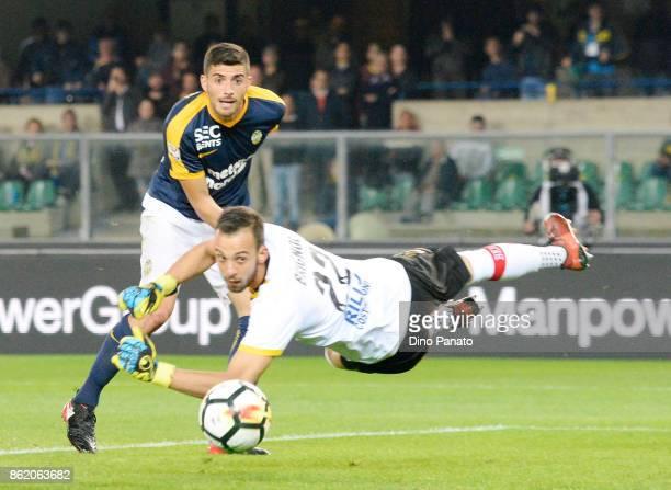 Mattia Vallotti competes with Alberto Brignoli goalkeeper of Benevento Calcio during the Serie A match between Hellas Verona FC and Benevento Calcio...