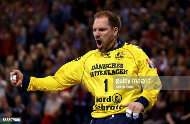 Mattias Andersson goaltender of Flensburg Handewitt celebrates after winning the Velux EHF Champions League round of 16 second leg match between SG...
