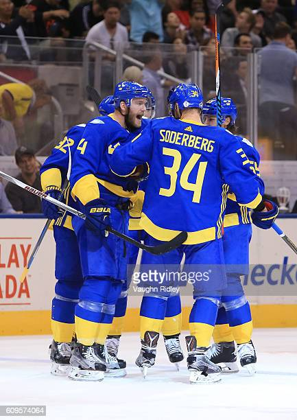Mattias Ekholm and Carl Soderberg celebrate after Team Sweden scores a third period goal on Team North America during the World Cup of Hockey 2016 at...