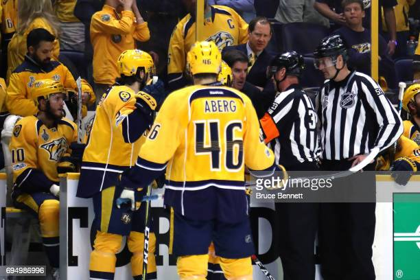 Mattias Ekholm and Pontus Aberg of the Nashville Predators look on as the referees review a play against the Pittsburgh Penguins during the second...