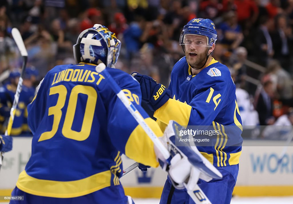 Mattias Ekholm #14 congratulates Henrik Lundqvist #30 of Team Sweden after a 2-0 shutout win over Team Finland during the World Cup of Hockey 2016 at Air Canada Centre on September 20, 2016 in Toronto, Ontario, Canada.