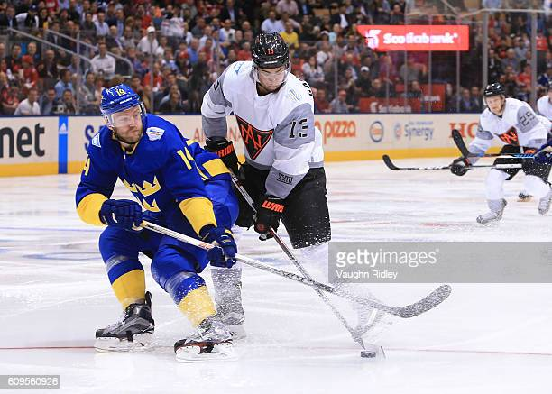 Mattias Ekholm of Team Sweden battles for the puck with Johnny Gaudreau of Team North America during the World Cup of Hockey 2016 at Air Canada...