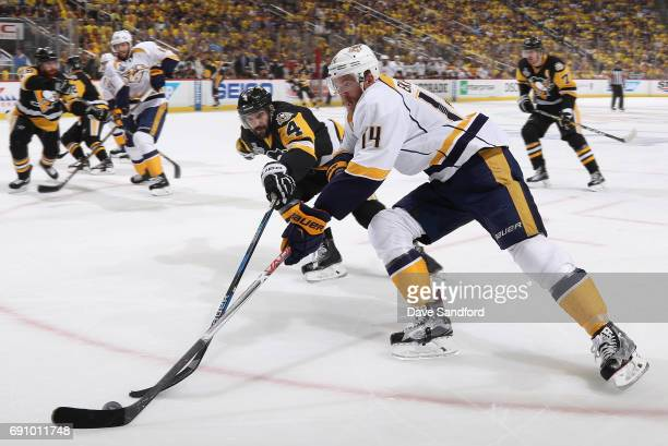 Mattias Ekholm of the Nashville Predators and Justin Schultz of the Pittsburgh Penguins battle for the puck during the first period of Game Two of...