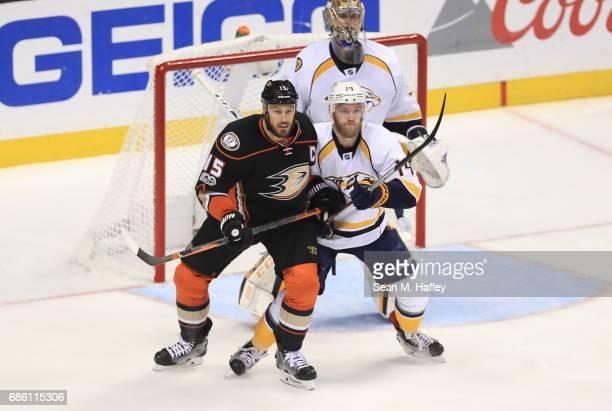 Mattias Ekholm of the Nashville Predators and Ryan Getzlaf of the Anaheim Ducks vie for position in front of goaltender Pekka Rinne of the Nashville...