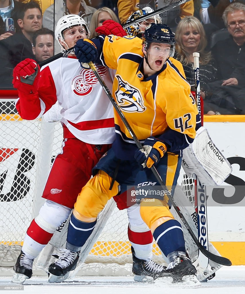 <a gi-track='captionPersonalityLinkClicked' href=/galleries/search?phrase=Mattias+Ekholm&family=editorial&specificpeople=6705085 ng-click='$event.stopPropagation()'>Mattias Ekholm</a> #42 of the Nashville Predators battles against <a gi-track='captionPersonalityLinkClicked' href=/galleries/search?phrase=Gustav+Nyquist&family=editorial&specificpeople=5491209 ng-click='$event.stopPropagation()'>Gustav Nyquist</a> #14 of the Detroit Red Wings at Bridgestone Arena on December 30, 2013 in Nashville, Tennessee.