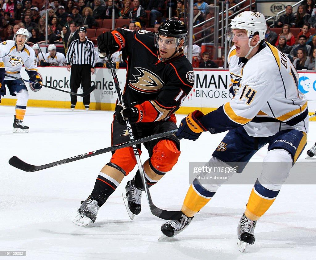 Mattias Ekholm #14 of the Nashville Predators battles for position against Rene Bourque #14 of the Anaheim Ducks on January 4, 2015 at Honda Center in Anaheim, California.