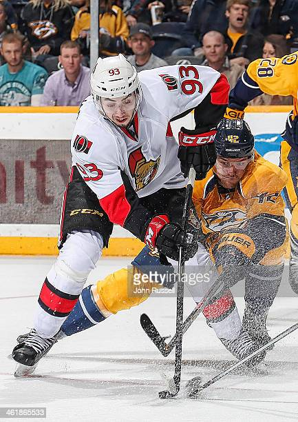 Mattias Ekholm of the Nashville Predators battles for the puck against Mika Zibanejad of the Ottawa Senators at Bridgestone Arena on January 11 2014...
