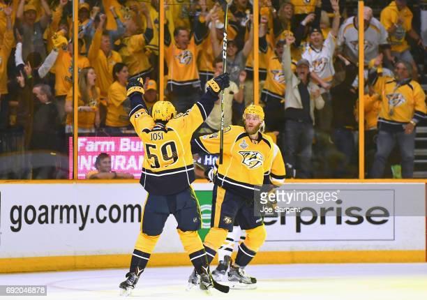 Mattias Ekholm of the Nashville Predators celebrates his third period goal with teammate Roman Josi during Game Three of the 2017 NHL Stanley Cup...