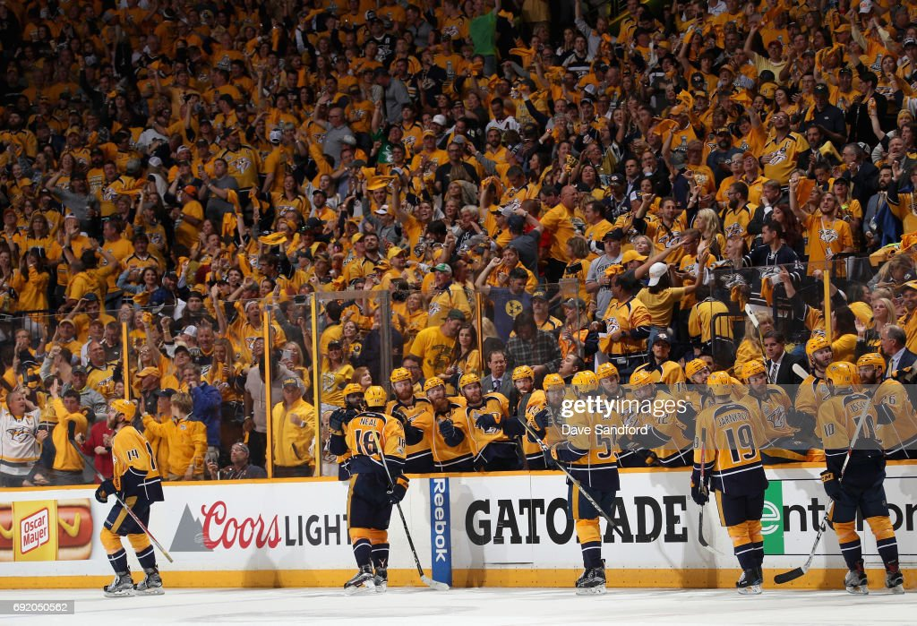 Mattias Ekholm #14 of the Nashville Predators celebrates his third period goal with teammates during Game Three of the 2017 NHL Stanley Cup Final against the Pittsburgh Penguins at Bridgestone Arena on June 3, 2017 in Nashville, Tennessee.
