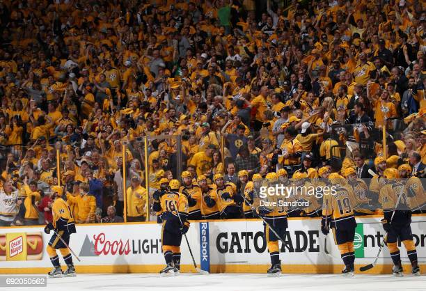 Mattias Ekholm of the Nashville Predators celebrates his third period goal with teammates during Game Three of the 2017 NHL Stanley Cup Final against...