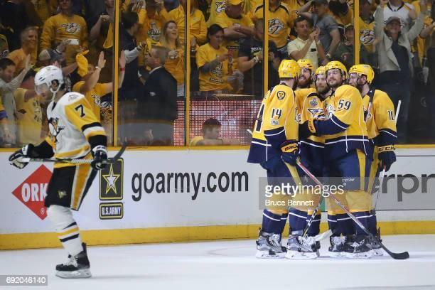 Mattias Ekholm of the Nashville Predators celebrates with teammates after scoring a third period goal against Matt Murray of the Pittsburgh Penguins...