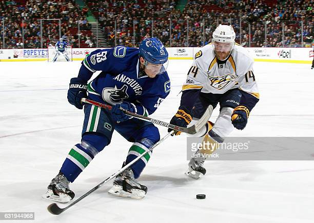 Mattias Ekholm of the Nashville Predators chases Bo Horvat of the Vancouver Canucks for the puck during their NHL game at Rogers Arena January 17...