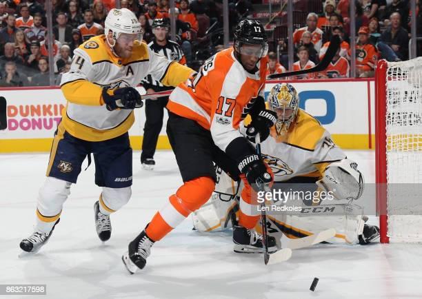 Mattias Ekholm of the Nashville Predators checks Wayne Simmonds of the Philadelphia Flyers in the back while protecting goaltender Pekka Rinne on...