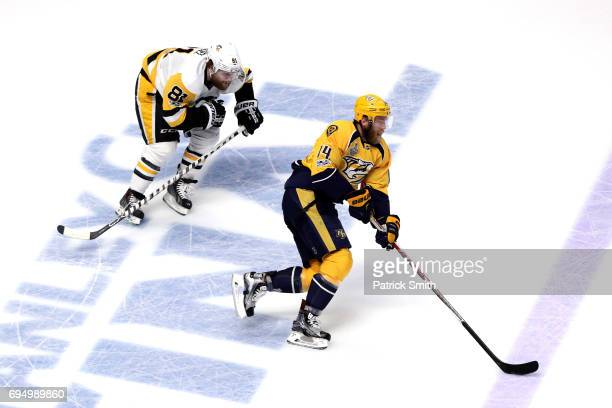 Mattias Ekholm of the Nashville Predators is pursued by Phil Kessel of the Pittsburgh Penguins during the first period in Game Six of the 2017 NHL...