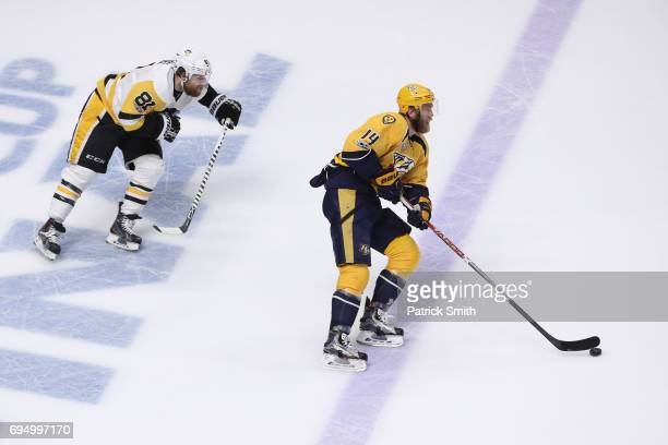 Mattias Ekholm of the Nashville Predators is pursued by Phil Kessel of the Pittsburgh Penguins during the second period in Game Six of the 2017 NHL...