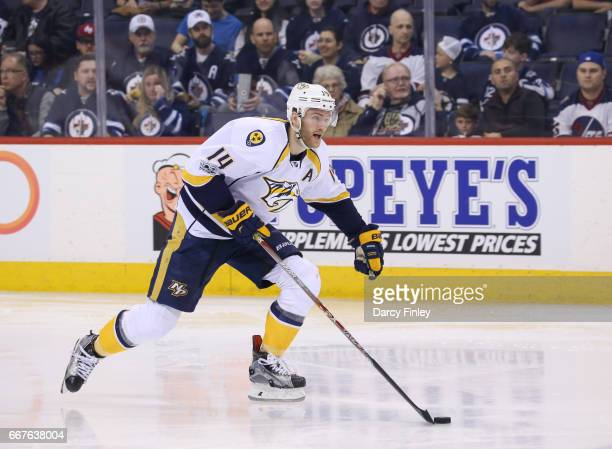 Mattias Ekholm of the Nashville Predators plays the puck down the ice during second period action against the Winnipeg Jets at the MTS Centre on...