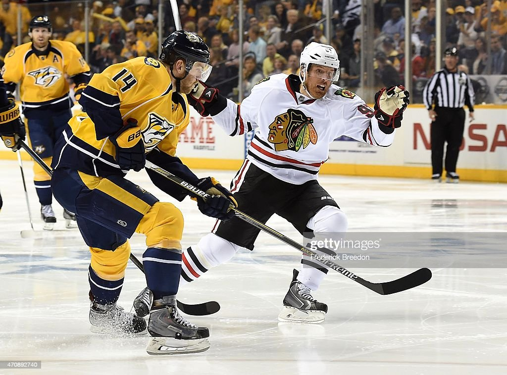 Mattias Ekholm #14 of the Nashville Predators skates against Brad Richards #91 of the Chicago Blackhawks during the third period of Game Five of the Western Conference Quarterfinals during the 2015 NHL Stanley Cup Playoffs at Bridgestone Arena on April 23, 2015 in Nashville, Tennessee.