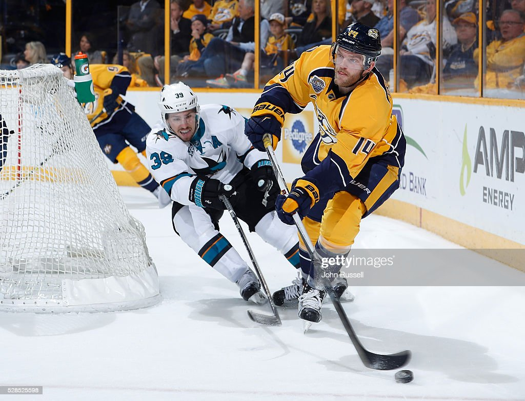 <a gi-track='captionPersonalityLinkClicked' href=/galleries/search?phrase=Mattias+Ekholm&family=editorial&specificpeople=6705085 ng-click='$event.stopPropagation()'>Mattias Ekholm</a> #14 of the Nashville Predators skates against <a gi-track='captionPersonalityLinkClicked' href=/galleries/search?phrase=Logan+Couture&family=editorial&specificpeople=809700 ng-click='$event.stopPropagation()'>Logan Couture</a> #39 of the San Jose Sharks in Game Four of the Western Conference Second Round during the 2016 NHL Stanley Cup Playoffs at Bridgestone Arena on May 5, 2016 in Nashville, Tennessee.