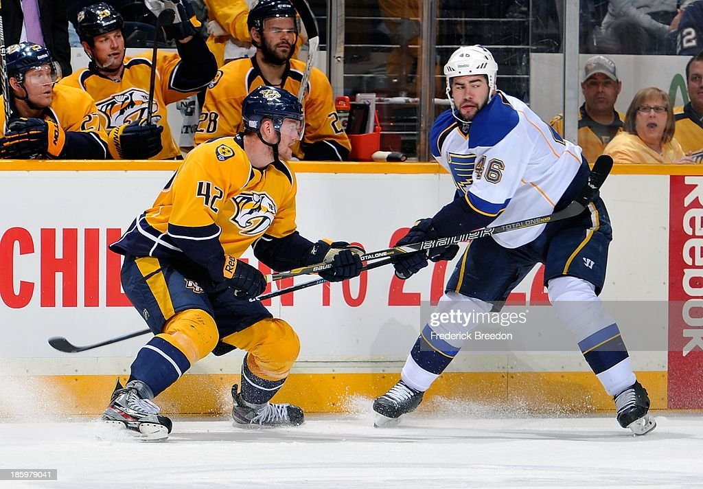 <a gi-track='captionPersonalityLinkClicked' href=/galleries/search?phrase=Mattias+Ekholm&family=editorial&specificpeople=6705085 ng-click='$event.stopPropagation()'>Mattias Ekholm</a> #42 of the Nashville Predators skates against Roman Polak #46 of the St. Louis Blues at Bridgestone Arena on October 26, 2013 in Nashville, Tennessee.