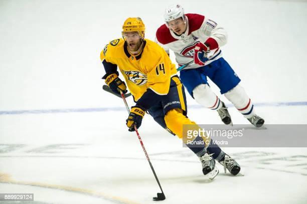 Mattias Ekholm of the Nashville Predators skates as Brendan Gallagher of the Montreal Canadiens chases during an NHL game at Bridgestone Arena on...
