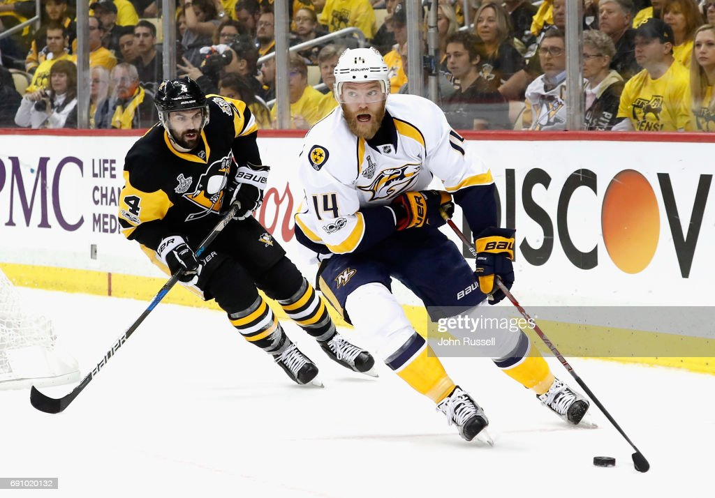 Mattias Ekholm #14 of the Nashville Predators skates away from Justin Schultz #4 of the Pittsburgh Penguins during the first period of Game Two of the 2017 NHL Stanley Cup Final at PPG Paints Arena on May 31, 2017 in Pittsburgh, Pennslyvannia.