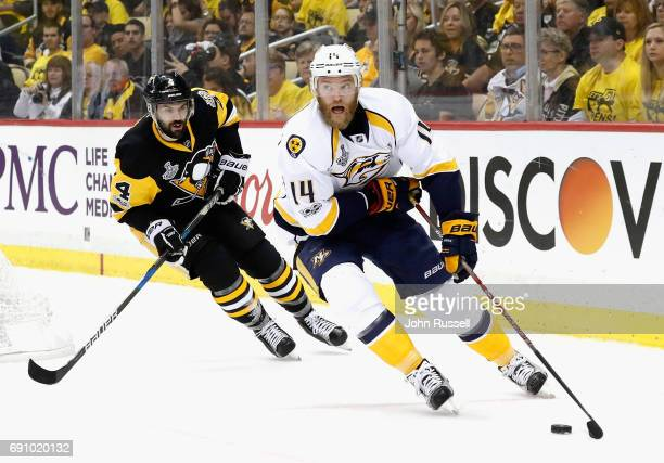 Mattias Ekholm of the Nashville Predators skates away from Justin Schultz of the Pittsburgh Penguins during the first period of Game Two of the 2017...