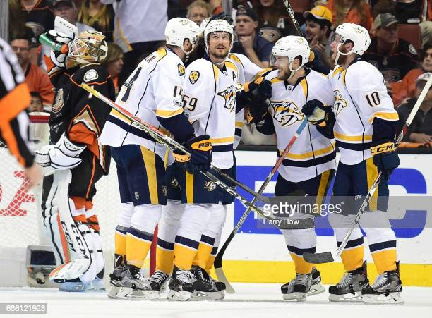 Mattias Ekholm Roman Josi Filip Forsberg Pontus Aberg and Colton Sissons of the Nashville Predators celebrate Aberg's goal as Jonathan Bernier of the...