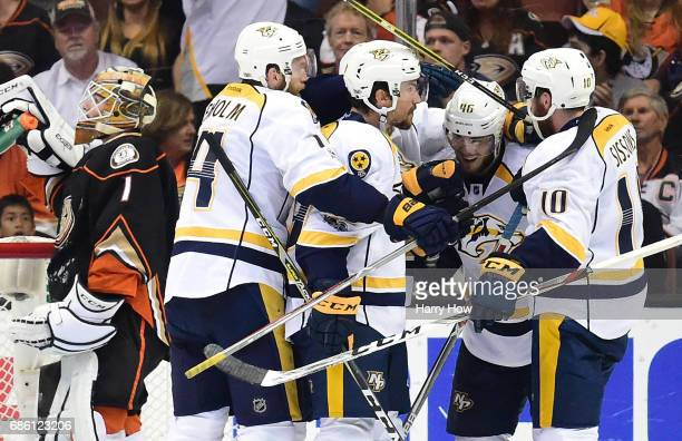 Mattias Ekholm Roman Josi=Pontus Aberg and Colton Sissons of the Nashville Predators celebrate Aberg's goal as Jonathan Bernier of the Anaheim Ducks...