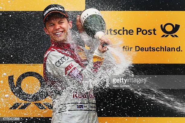 Mattias Ekstroem of Sweden and Audi Sport Team Abt Sportsline celebrates winning during the second race of the DTM 2015 German Touring Car...