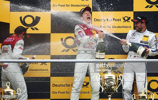 Mattias Ekstroem of Sweden and Audi Sport Team Abt Sportsline celebrates winning the second race of the DTM 2015 German Touring Car Championship with...