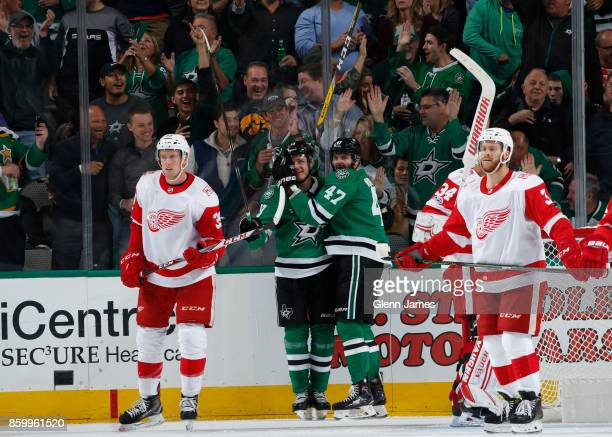 Mattias Janmark and Alexander Radulov of the Dallas Stars celebrate a goal against the Detroit Red Wings at the American Airlines Center on October...