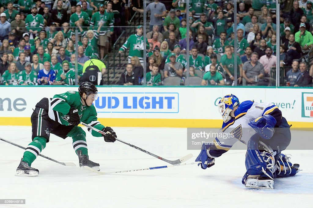 Mattias Janmark #13 of the Dallas Stars scores against Brian Elliott #1 of the St. Louis Blues in the third period in Game Two of the Western Conference Second Round during the 2016 NHL Stanley Cup Playoffs at American Airlines Center on May 1, 2016 in Dallas, Texas.