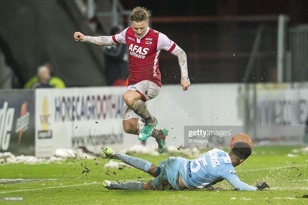 Mattias Johansson of AZ Alkmaar, Marvin Peersman of FC Dordrecht during the Dutch Eredivisie match between AZ Alkmaar and FC Dordrecht at AFAS stadium on January 17, 2015 in Alkmaar, The Netherlands