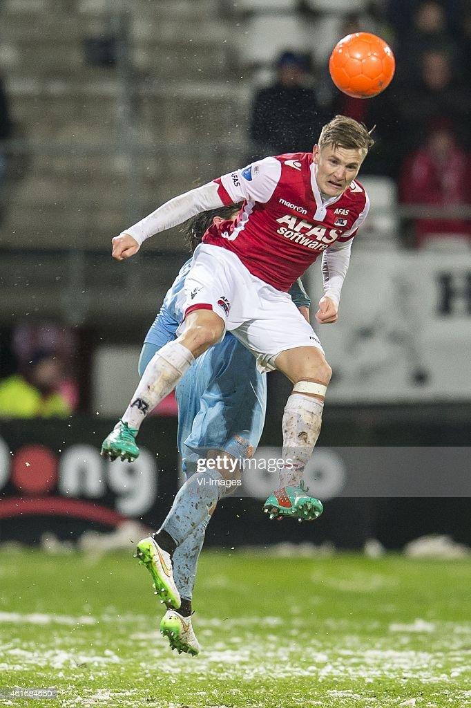 Mattias Johansson of AZ Alkmaar, Rick ten Voorde of FC Dordrecht during the Dutch Eredivisie match between AZ Alkmaar and FC Dordrecht at AFAS stadium on January 17, 2015 in Alkmaar, The Netherlands