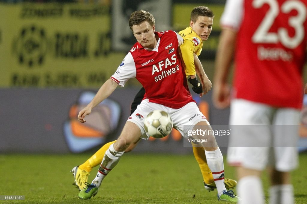 Mattias Johansson of AZ (L), Amin Affane of Roda JC (R) during the Dutch Eredivisie match between Roda JC Kerkrade and AZ Alkmaar at the Parkstad Limburg Stadium on february 16, 2013 in Kerkrade, The Netherlands