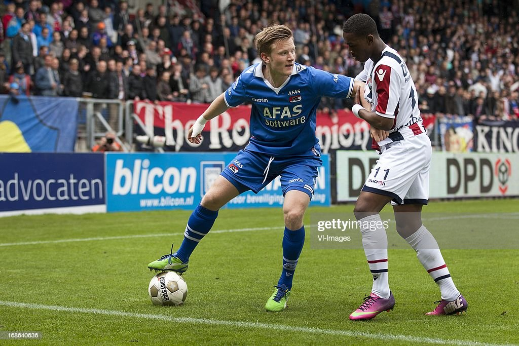Mattias Johansson of AZ, Virgil Misidjan of Willem II during the Dutch Eredivisie match between Willem II and AZ Alkmaar on May 12, 2013 at the Koning Willem II stadium in Tilburg, The Netherlands.