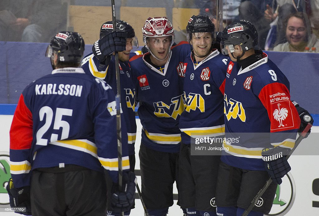 Mattias Karlsson #25 of HV71 <a gi-track='captionPersonalityLinkClicked' href=/galleries/search?phrase=Erik+Christensen&family=editorial&specificpeople=870252 ng-click='$event.stopPropagation()'>Erik Christensen</a> #24 of HV71 Ted Brithen #90 of HV71 and <a gi-track='captionPersonalityLinkClicked' href=/galleries/search?phrase=Bjorn+Melin&family=editorial&specificpeople=640939 ng-click='$event.stopPropagation()'>Bjorn Melin</a> #9 of HV71 celebrate after HV71 scored 3-2 during the Champions Hockey League group stage game between HV71 Jonkoping and Red Bull Salzburg on August 24, 2014 in Jonkoping, Sweden.