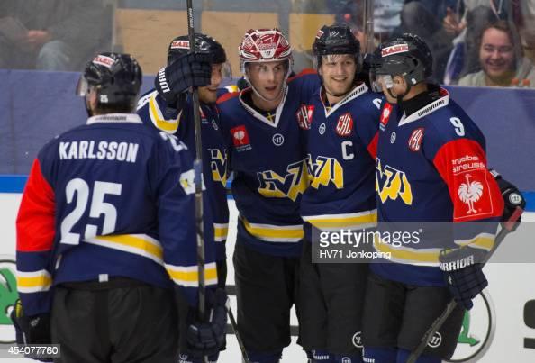 Mattias Karlsson of HV71 Erik Christensen of HV71 Ted Brithen of HV71 and Bjorn Melin of HV71 celebrate after HV71 scored 32 during the Champions...
