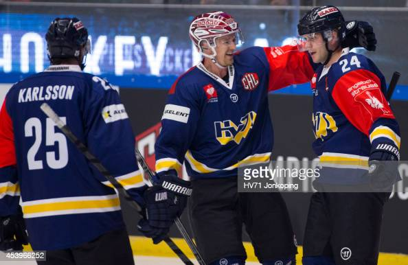 Mattias Karlsson of HV71 Ted Brithén of HV71 celebrates Erik Christensen of HV71 first goal of the game during the Champions Hockey League group...